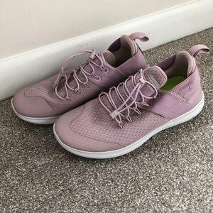 Blush Nike running shoes